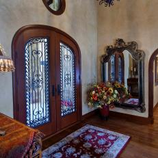 Tuscan Foyer With Ornate Front Doors
