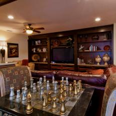 Tuscan-Style Living Room Features Elegant Chess Table
