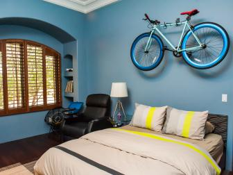 Wall-Mounted Bike Serves as Decor in Boy's Bedroom