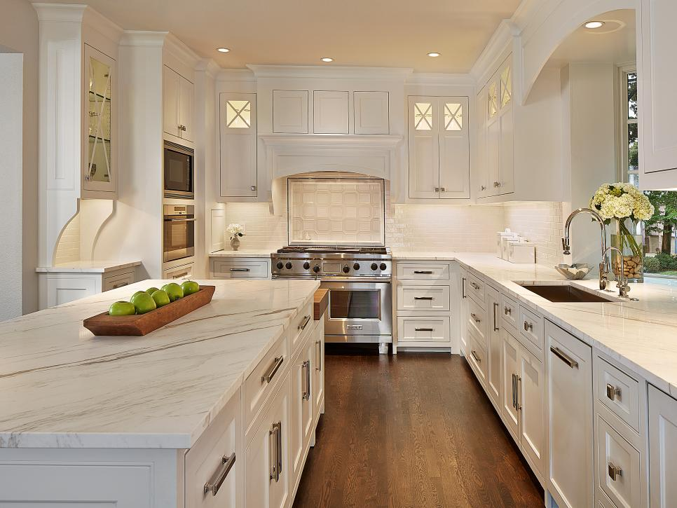 White Kitchen With Glass Front Cabinets and Dark Hardwood Floors