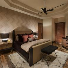 Rustic Guest Room With Chevron Accent Wall