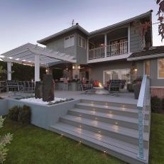 Transitional Gray Home Exterior With Spacious Back Porch