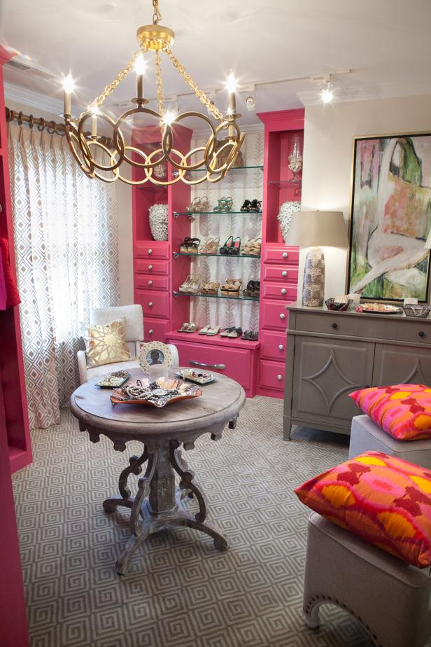Glam Closet With Pink Shelving and Chandelier