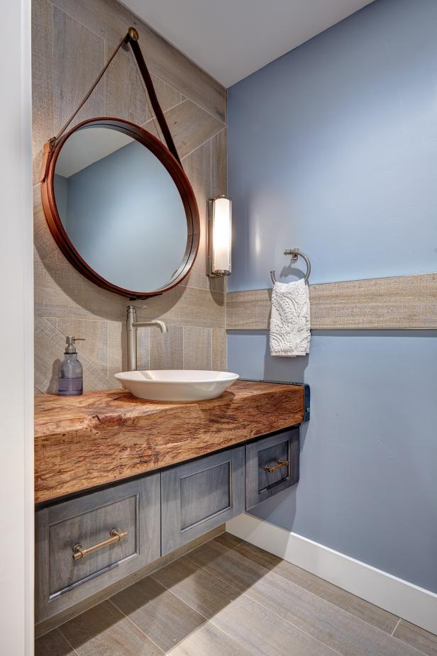 Bathroom with vessel sink atop a wooden vanity counter.