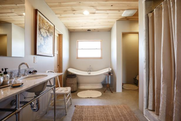 Neutral Bathroom With Wood Paneled Ceiling and Freestanding Tub