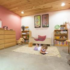 Pink Girl's Room With Light Wood Accents