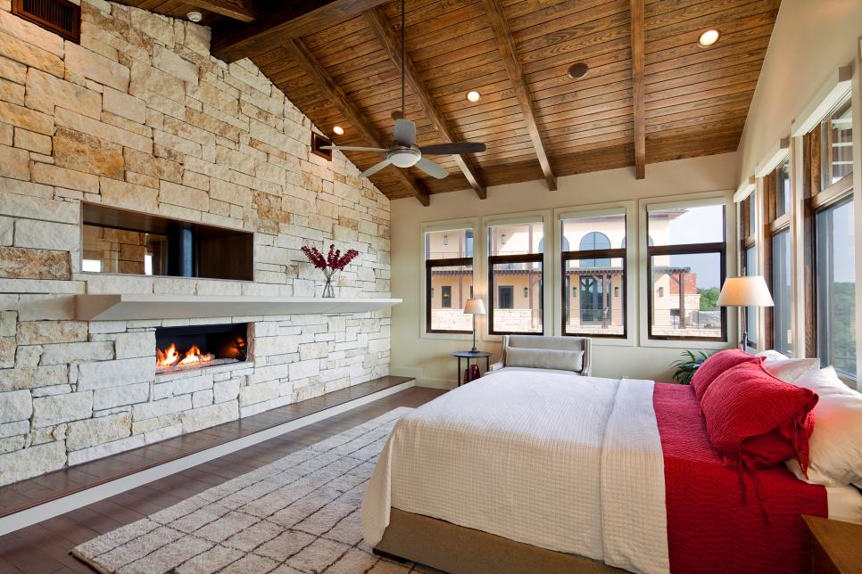 HGTV shows you 20 inspiring fireplace designs that cozy up the bedroom.