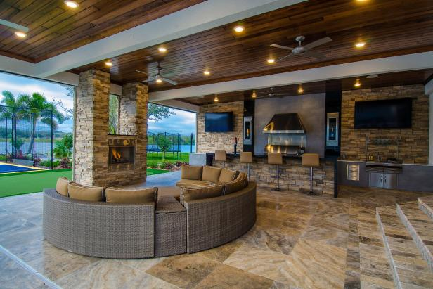 Covered Patio Boasts Cozy Seating Area & Outdoor Kitchen
