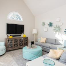 Contemporary Living Room Features Gray Sectional Aqua Pleather Ottoman