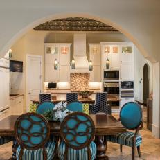 Moroccan Dining Room With Bright Turquoise Chairs And Sturdy Wood Table