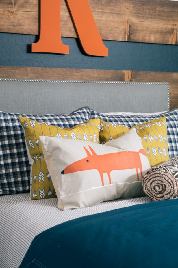 Close up on Bed Setting With Navy, Orange & Yellow Accents