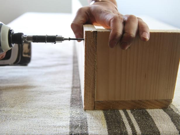 Coat the wood with foam and fabric spray adhesive.