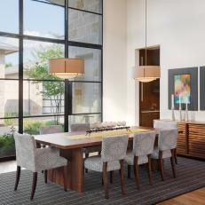 Contemporary Dining Room With Floor-to-Ceiling Windows