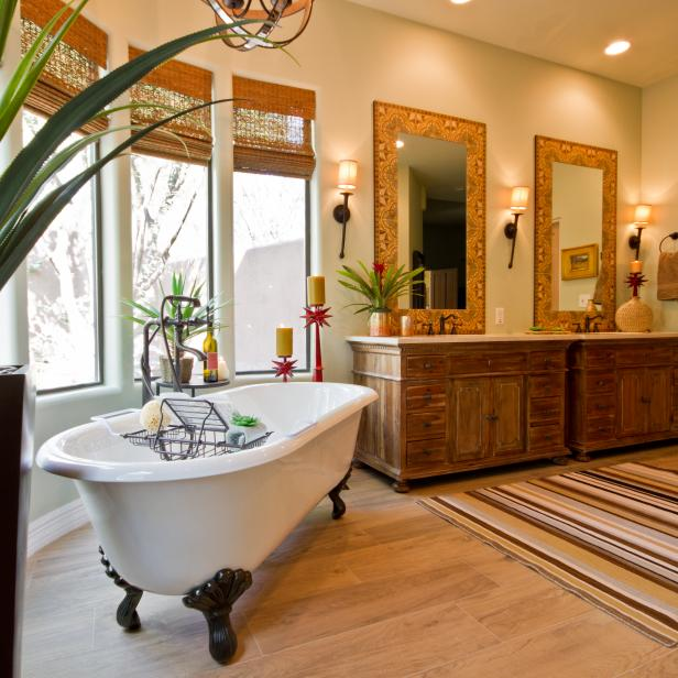 Neutral Southwestern Bathroom With White Freestanding Bathtub