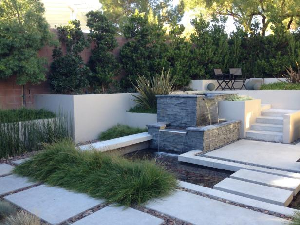 Pavers Surround Ornamental Grass & Small Pond in Modern Backyard