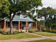 Blue Farmhouse With Natural Wood Fencing