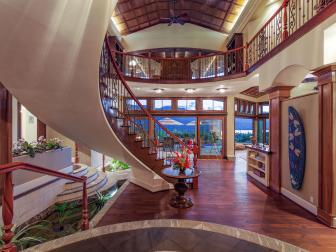 Tropical Foyer With Grand Staircase and Balcony Overlook