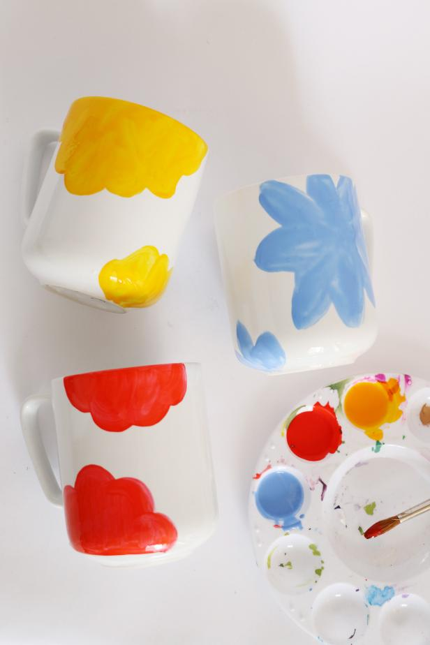 Make your abstract floral shape very large and going off the top of the mug. Add a few more petals near the bottom of the mug.