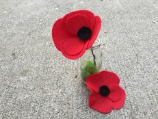 Poppies are normally a Memorial Day tradition, but these easy fabric flowers make a great decoration anytime of year.  We have instructions on how to make a poppy pin and a stemmed flower.