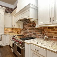 French Country Kitchen With Red Brick Accent Wall