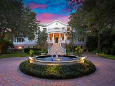 Picturesque Sunset Over Sarasota Home With Stone Driveway and Gorgeous Stairwell