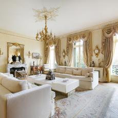 Lavish Victorian Living Room in Paris With White Furniture Heavy Drapery and Gold Decorative Details & Victorian Living Room Photos | HGTV