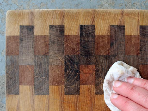 Use a damp rag to remove sanding dust so you can see where you need to continue sanding.