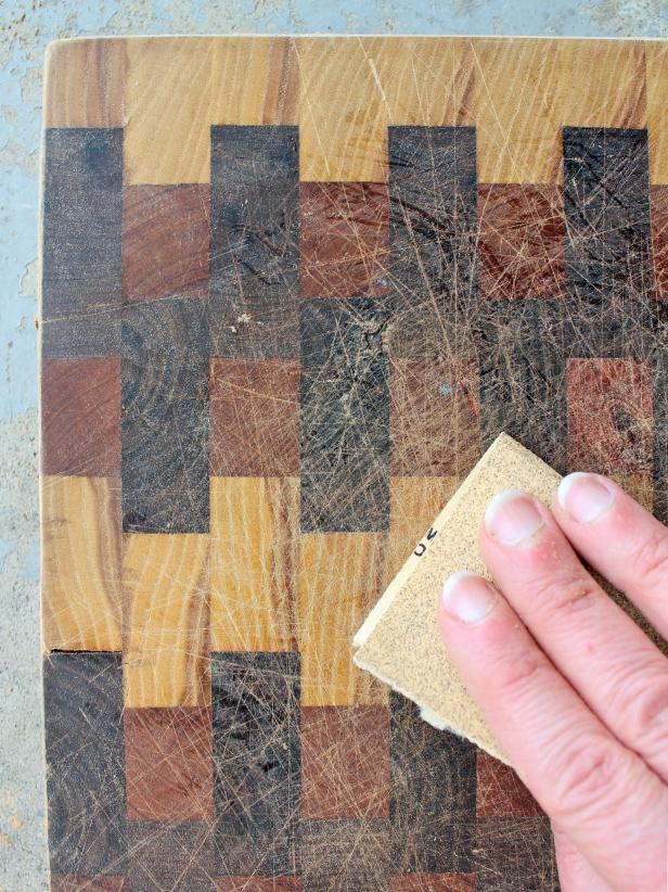 Working from coarse- to fine-grit, thoroughly sand cutting board's surface.