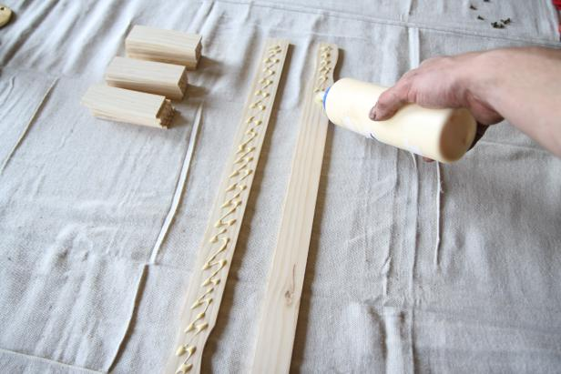 Apply wood glue to two full-length paint sticks.