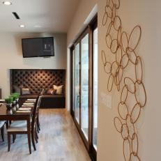Dark Furniture and Geometric Wall Design in Chef's Kitchen