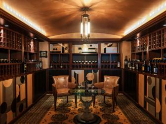 Graphic Cabinetry Designs, Metallic Ceiling Create Art Deco Style in Wine Cellar