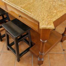 Marble-Topped Kitchen Island with Dark Wood Stools