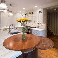 bright kitchen features round wood block built onto island - Round Kitchen Island