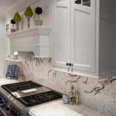 Detail of White Cabinetry, Marble Countertops & Kitchen Backsplash