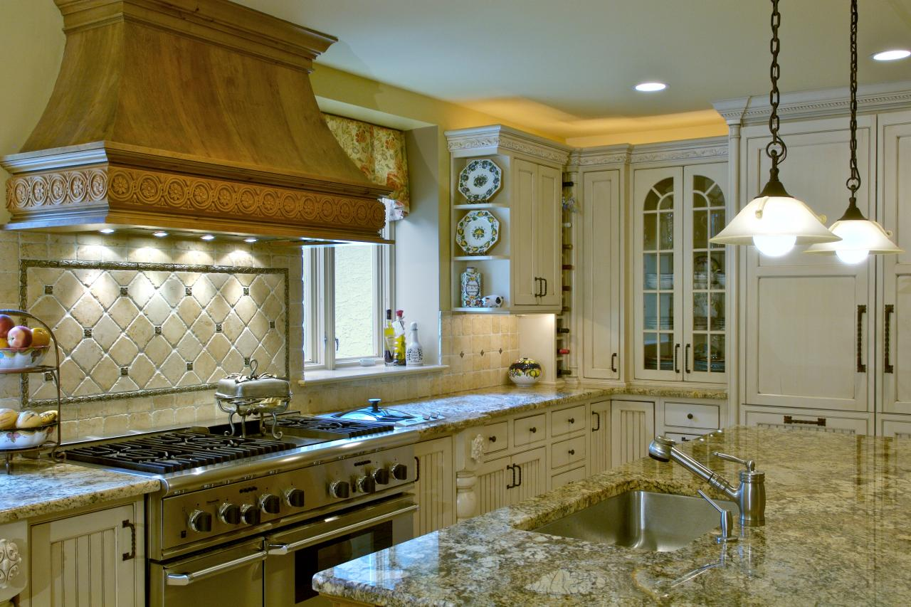 Traditional eat in kitchen features beautiful granite countertops and cream cabinets hgtv for Eat in kitchen designs for small kitchen