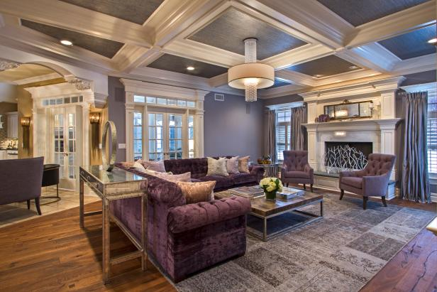 Beautiful contemporary living room with violet velvet sofa lavender details and coffered ceiling