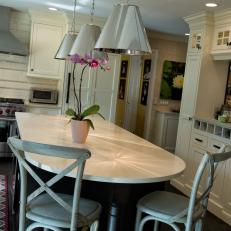 Fun Metal Pendant Lights Excite In A Transitional Kitchen With Large Island & Painted Industrial Chairs