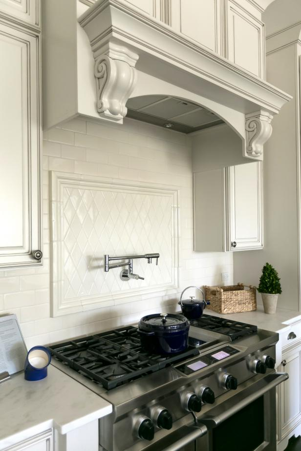 Custom Cabinets and Backsplash Add Elegance While Double Ovens and Gas Stove Ensure Functionality