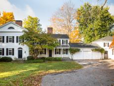 White Colonial Home on Wooded Lot