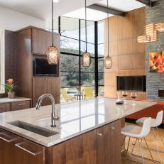 Contemporary Open Plan Kitchen With Warm Wood Cabinets