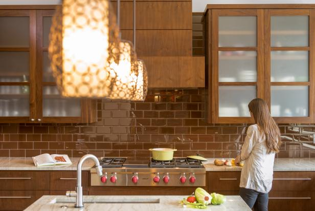 contemporary kitchen features brown subway tile backsplash