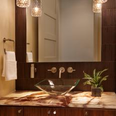 Stylish, Contemporary Powder Room With Onyx Countertop & Glass Vessel Sink