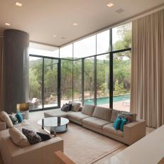 Open, Modern Living Room With Floor Length Curtains and Glass Walls