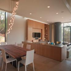 Modern Open Plan Dining Room With Cascading Light Fixture