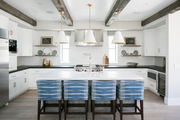 Transitional White Kitchen With Wood Ceiling Beams and White Pendants
