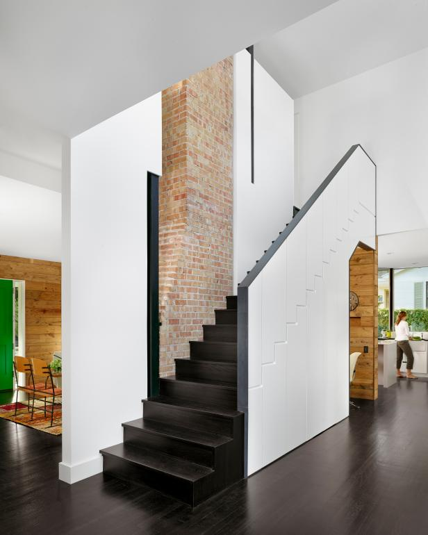 Modern Staircase with Exposed Brick Chimney