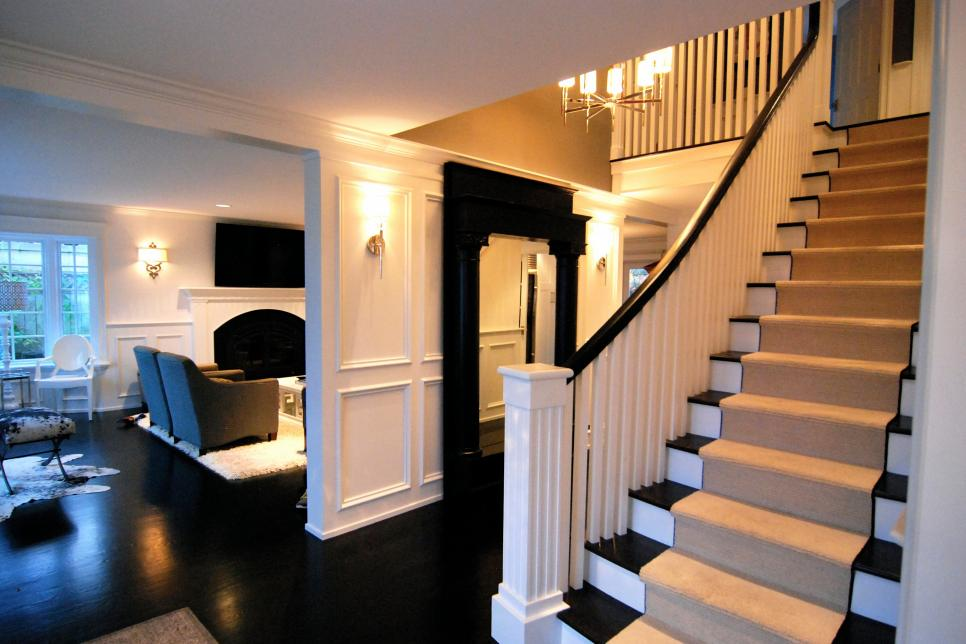 Sleek Black and White Staircase and Foyer