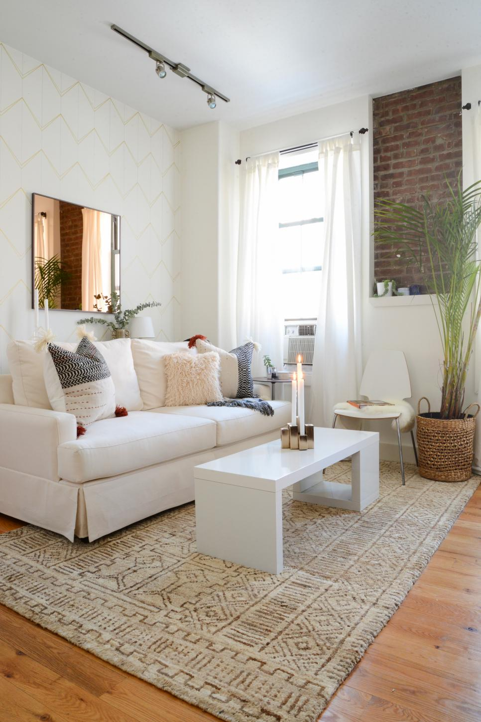 White Living Room With Cream Sofa, White Coffee Table and Tan Rug