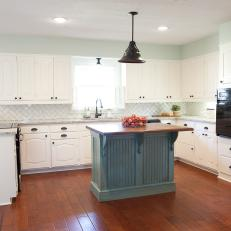 Blue and White Cottage Kitchen With Blue Island