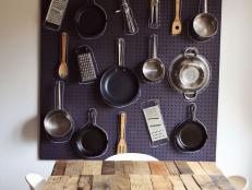 Pots and Pans Displayed on Pegboard